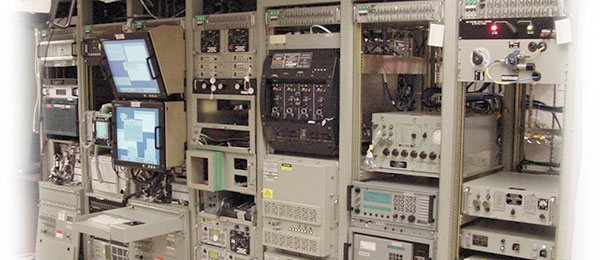 Submarine radio room with Marway custom PDUs at the top of each rack.