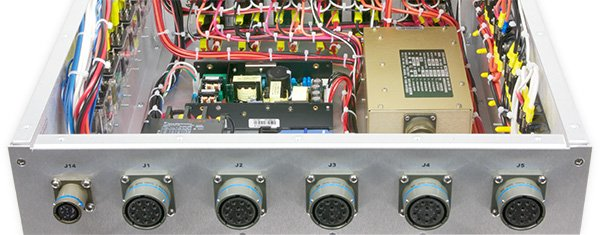 Photo of the inside of a 400 hertz PDU from the rear showing circular connectors on the rear panel.
