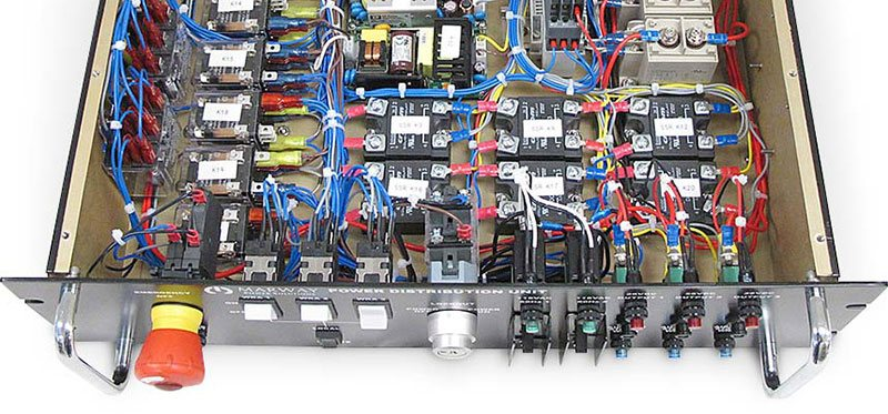 Photo of open PDU showing front panel controls, and power supplies and several relays inside.