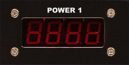 A photo of a digital LED display used to show the voltage of a powe line.